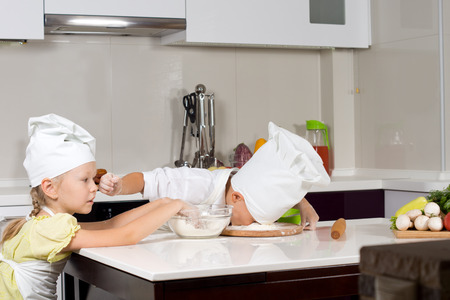 Two young chefs having fun in the kitchen photo