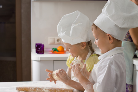 vivacious: Cute Kid Chefs Baking for Pizza at the Kitchen