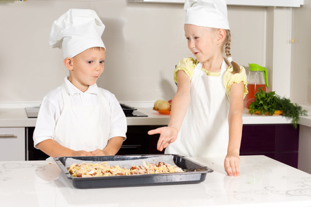 Cute Little Kids Bake Something to Eat at the Kitchen photo