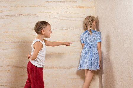 dictatorial: Cute Little White Kids Playing at Home While Parents Not Around.
