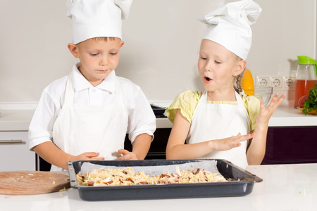 Little Cute Chefs Made Delicious Food of the Day at the Kitchen. photo