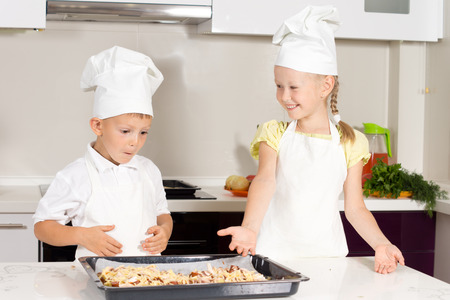 Cute Little Kids Made Delicious Pizza on White Table photo