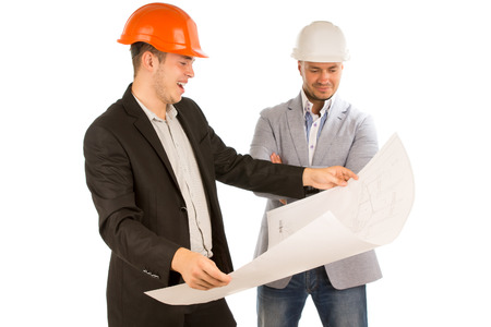 bundling: Young architect holding a bundling plan unrolled in his hands watched by his partner as he stands smiling and studying the details, on white