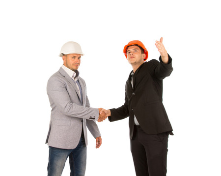 Two Middle Age Building Designers in Gray and Black Coats Shaking Hands. Isolated on White Background. photo