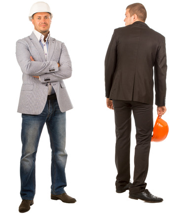 Two Male Middle Age Engineers, One is Looking at Camera While the Other is Facing Backward, on White Background photo