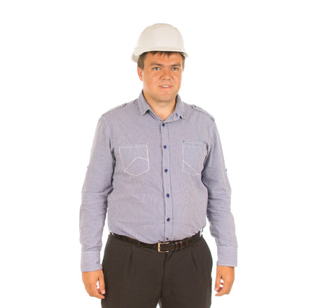 unemotional: Young architect , builder, engineer or construction worker standing posing in his hardhat, isolated on white