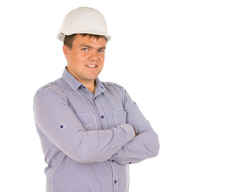 inscrutable: Confident friendly architect or engineer standing in his hardhat with folded arms smiling at the camera, isolated on white