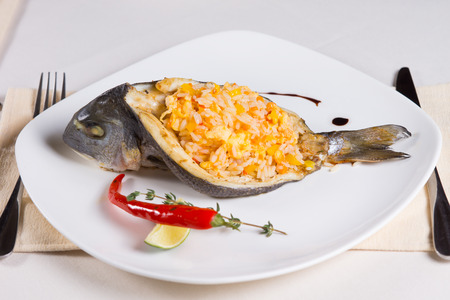 stuffed fish: Rice Stuffed Fish Dish on Plate Place Setting in Restaurant