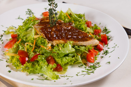 plating: Close up Delicious Meaty Dish on Lettuce and Tomatoes in Nice Plating. Stock Photo
