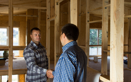 building planners: Male Building Planners Doing Handshake After the Deliberation of Proposed Designs. Emphasizing Positive Agreement. Stock Photo
