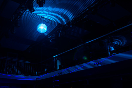 Looking Up at Blue Light Disco Ball in Night Club Imagens