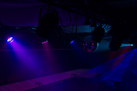 Purple and Blue Spotlights in Empty Night Club Imagens