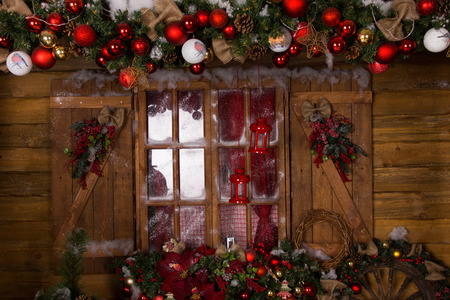christmas lights display: Beautiful Christmas Decoration with Assorted Ornaments at Glass House Window with Wooden Frame.