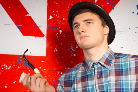characterization: Close up Thoughtful Handsome Young Man in Trendy Attire with Tobacco Smoking Pipe Looking Up.