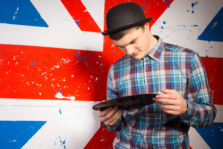olden day: Close up Handsome Man in Trendy Outfit Holding Vinyl Record Plate in Front Britain Flag Print