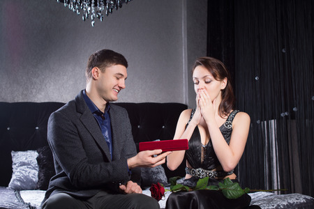 suitor: Close up Pretty Young Woman Received a Jewelry Gift From Boyfriend, Emphasizing her Surprise Reaction. Stock Photo