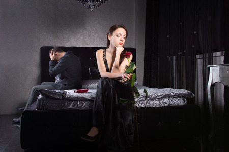 disinterested: Young Couple in Formal Wear Fighting for Something While at the Bedroom