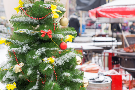 street market: Close up Attractive Decorated Christmas Tree with Balls and Ribbons at Street Market Stock Photo