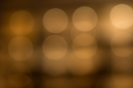 emphasizing: Glowing Lights Behind Brown Transparent Glass in Attractive Diffuse Effect, Emphasizing Copy Space Stock Photo