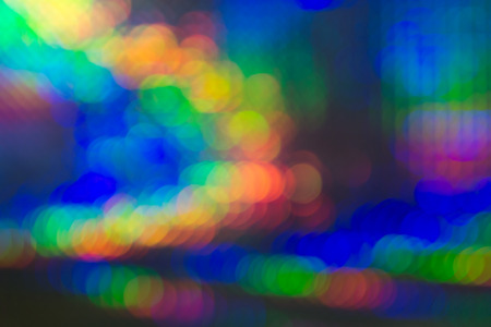 soft diffused light: Abstract background of vivid colorful circular bokeh forming an arc in the colours of the rainbow for a festive occasion Stock Photo