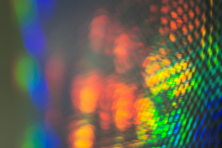 soft diffused light: Abstract Background of Reflected Spectrum Light with Spotted or Scaled Texture Stock Photo