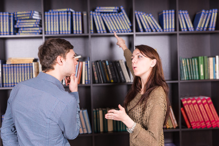 tomes: Close up Young White Couple Deciding What Book to Read at the Mini Library Stock Photo