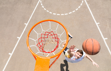 outdoor basketball court: High Angle View from Backboard of Young Athletic Man Making Lay Up Shot on Net on Outdoor Basketball Court