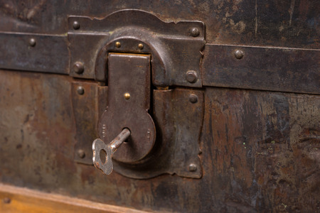 treasure trove: Close Up of Rusty Lock and Key Belonging to Antique Wooden Trunk with Weathered Wood