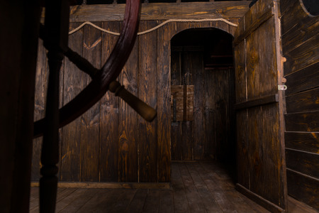 Detail of Open Door Leading to Cabin and Interior Living Quarters of Antique Wooden Sailing Ship