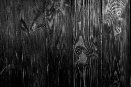 floorboards: Black and white full frame of wooden floor boards shot from directly above, knots visible in wood
