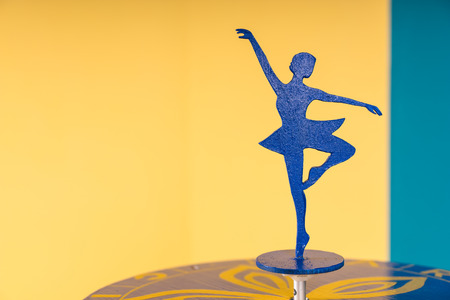 ballerina silhouette: Ballerina Silhouette on Table in Colorful Room