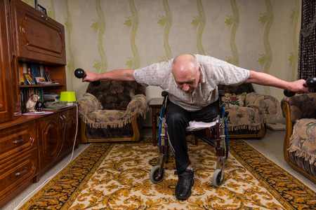 leaned: Invalid old man leaned and doing exercises