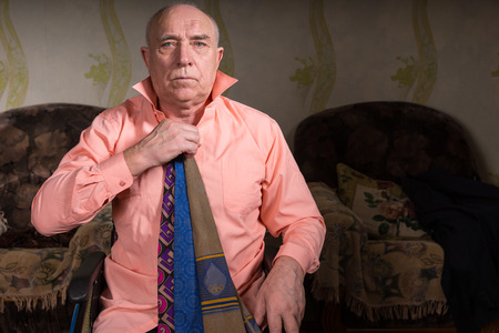 natty: Handsome old man trying on several ties