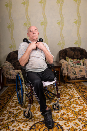 amputated: Full Length Portrait of Senior Man with Amputated Leg Sitting in Wheelchair Holding Handheld Dumbbells in Comfort of Home in Living Room