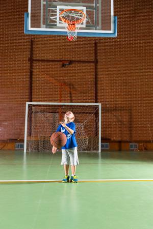 Small Boy Playing Basketball Walking Along Bouncing The Ball.. Stock ...
