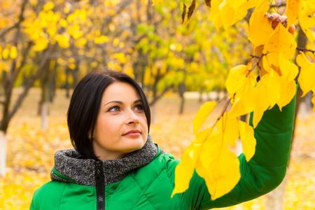 appreciating: Young woman appreciating the autumn colors