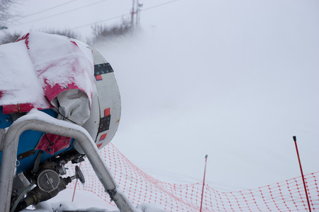 ski runs: Close up of a winter snow machine for producing artificial snow to help cover ski runs at a mountain resort