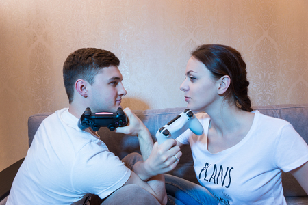mesmerized: Emotions running high after playing a game as a young man and his wife threaten each other with their gaming consoles