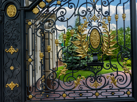 iron door: Luxury iron door of a gate to the entrance of a beautiful park Stock Photo