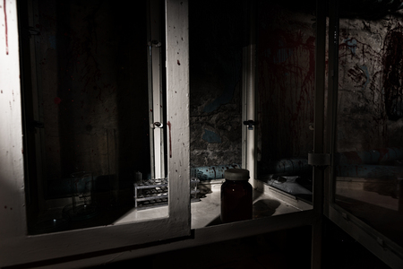 evocative: Frightening Halloween theme blood of stained laboratory with glass case and test tubes holder inside