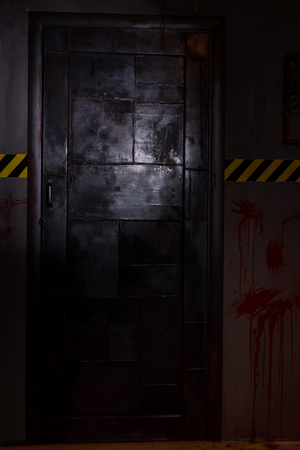 grisly: Big iron black door in basement in a Halloween horror concept Stock Photo