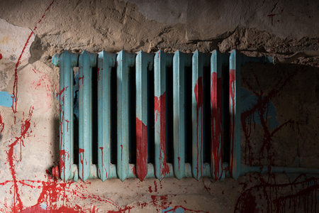 maniacal: Bloodied battery in dimly lit basement in a Halloween horror concept Stock Photo