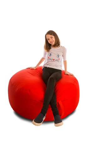 round chairs: Young girl sitting on round shape red beanbag chair isolated on white background Stock Photo