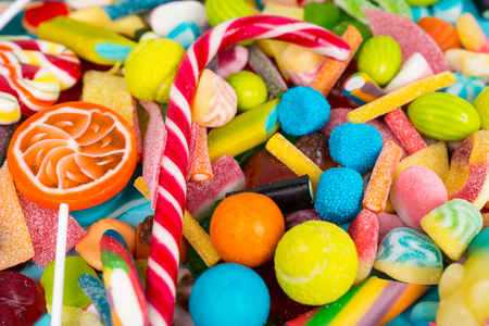 Close up of cattered tasty lollipops, chewing sweets and jelly candies Stock Photo