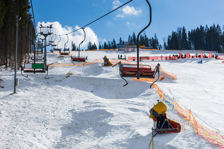 Empty ski lifts in a ski-resort in winter period on a sunny day