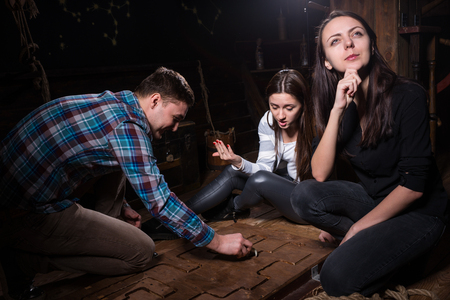 Young emotional people thinking, moving parts of a conundrum and trying to get out of the trap, escape the room game concept