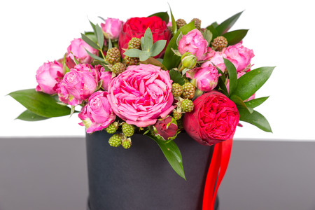 Incredible bouquet of pink roses and red ribbon in a concept of love, romance, anniversary, Valentines day or wedding