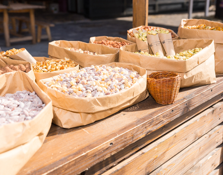Different kinds of nuts in paper containers outdoor on food festival. Food and beverages concept