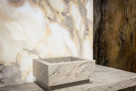 Square washbasin near white and dark marble walls. Concept of home interior