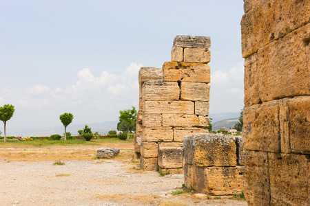 Ancient Greek ruins at Hierapolis, Anatolia, Turkey with remnants of old buildings made with blocks of stone in a close up view in a rural landscape